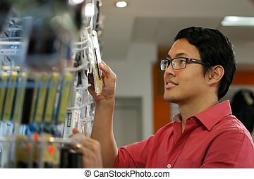 Happy Chinese Man Ordering Usb Drive In Computer Shop