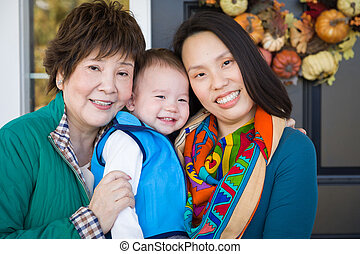 Happy Chinese Senior Adult Grandmother with Her Daughter and Grandson