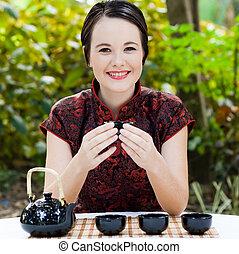 happy chinese tea waitress