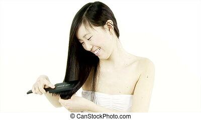 Happy Chinese woman brushing