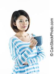 Happy Chinese woman holding a mug.