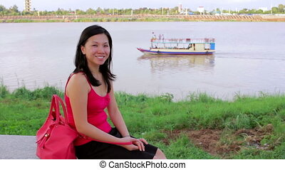 Happy chinese Young Woman by riverside