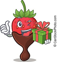 Happy chocolate strawberry character having a gift box