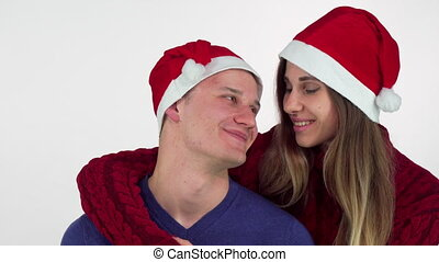 Happy Christmas couple hugging and smiling at each other