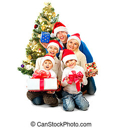 Happy Christmas family with gifts isolated on white