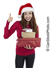 Happy christmas gift woman showing thumbs up
