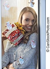 happy christmas girl at window