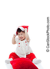 Happy christmas girl playing happily