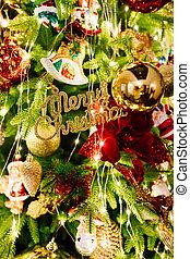 happy Christmas inscription on the background elegant Christmas tree