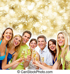 Happy Christmas people drinking champagne