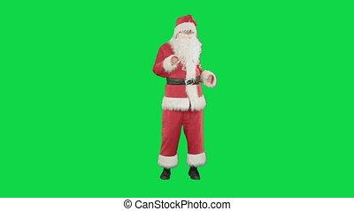 Happy Christmas Santa Claus having fun and dancing on a...