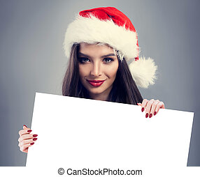 Happy Christmas Woman Brunette with White Banner Background with Empty Copy space. Cute Girl in Santa Hat, Winter Woman Christmas Concept
