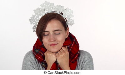 Happy Christmas woman in snowflakes headband wearing winter scarf