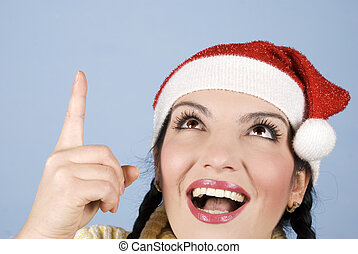 Happy Christmas woman pointing up