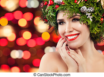 Happy Christmas woman smiling on bright bokeh sparkle background