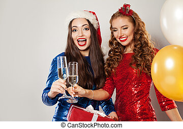 Happy Christmas women laughing on white background
