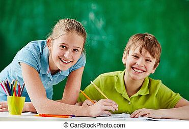 Happy classmates at lesson