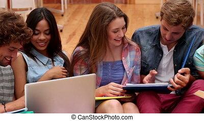 Happy classmates sitting on bean b