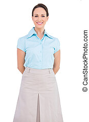 Happy classy young businesswoman posing on white background