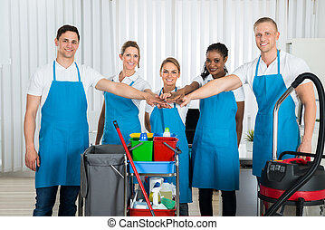 Happy Cleaners Stacking Hands - Group Of Happy Cleaners In...