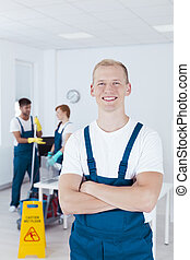 Happy cleaning staff - Young happy cleaning staff working in...