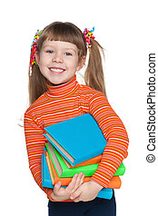 A portrait of a happy clever little girl with books against the white background