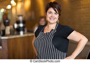 Happy Coffee Shop Owner - Portrait of happy young female...