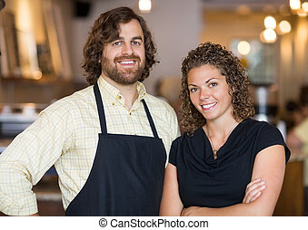 Happy Coffee Shop Owners - Portrait of happy male and female...
