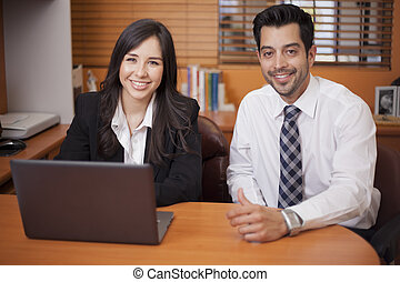 Happy colleagues working together - Happy businessman and...