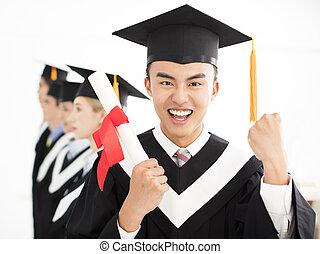 happy college graduate at graduation with classmates