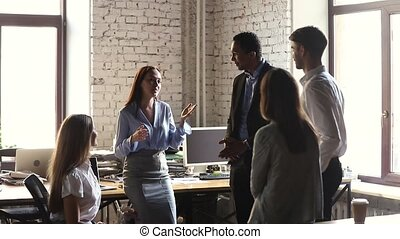Happy company leader motivating diverse business team give...