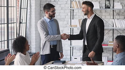 Happy company manager handshake promote praise male worker in office