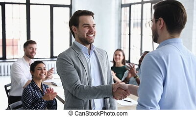 Happy confident businessman best employee being promoted handshake executive manager rewarding male office worker express respect applauding praising for professional skills, recognition concept
