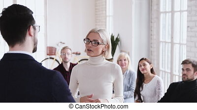 Happy confident young businesswoman get promoted handshaking boss