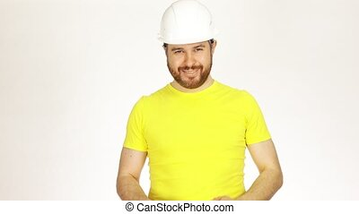 Happy construction engineer or architect in yellow tshirt and hard hat using measure tape against white background. 4K video