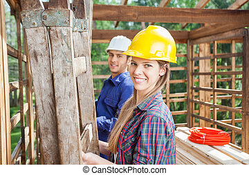 Happy Construction Worker With Colleague At Site - Portrait...