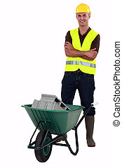 Happy construction worker with wheelbarrow