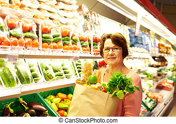 Happy consumer - Image of senior woman in groceries ...