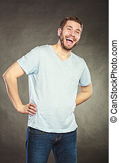 Happy content handsome man guy laughing.