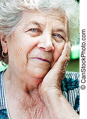 Happy content senior old woman