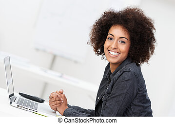 Happy contented young woman with an afro hairstyle - Happy...