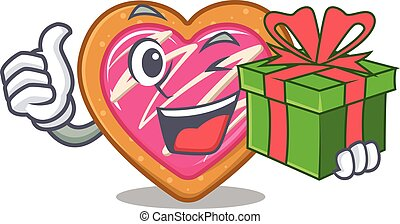 Happy cookie heart character having a gift box