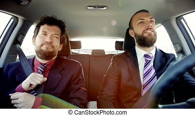 happy cool business men in car