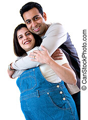 Happy couple - A happy East Indian couple expecting a baby