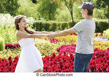 Happy couple among flowers