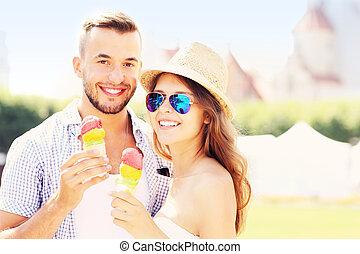 Happy couple and ice-cream