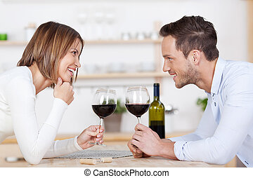 Happy couple and red wine