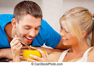 happy couple at home - bright picture of happy couple with...