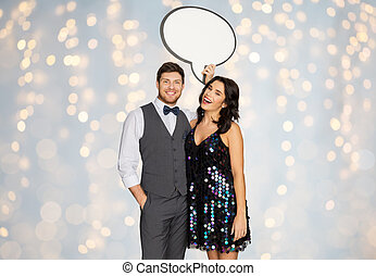 happy couple at party holding text bubble banner