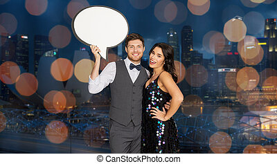 happy couple at party holding text bubble banner - holidays,...